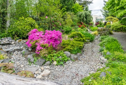 9. This dry creek bed includes features such as large stepping stones