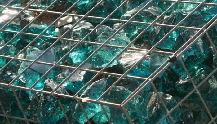 15. One of the many decorative rock options to consider is colored glass. Lights can