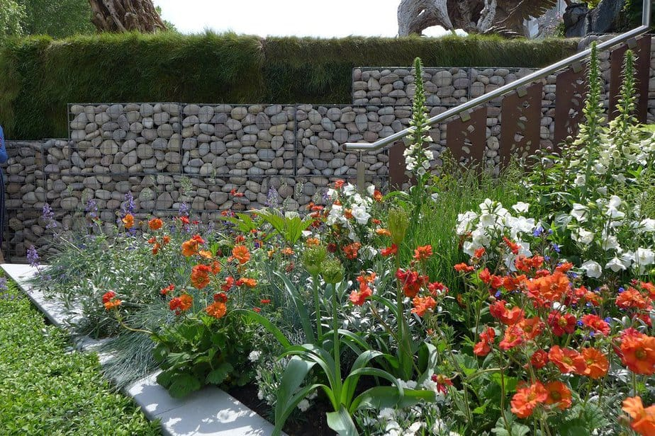 3. This river rock gabion wall serves as both a property fence and